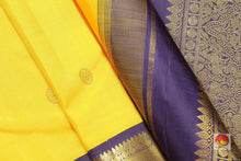 fabric detail of silk yarn in yellow kanjivaram silk saree