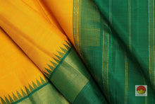 Load image into Gallery viewer, fabric detail of silk yarn in yellow temple border kanjivaram silk saree
