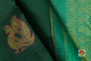 fabric detail of silk yarn in bottle green kanjivaram silk saree