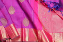 body and border detail of purple  kanjivaram silk saree