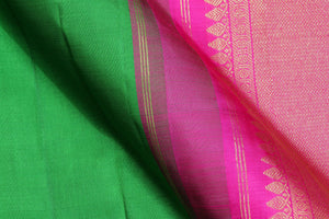 fabric detail of green silk yarn in handwoven kanjivaram silk saree