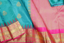 body and border of green kanjivaram silk saree
