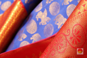 zari detail and fabric texture of royal blue kanjivaram pure silk saree