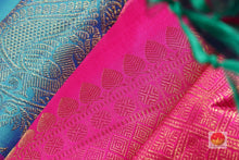 fabric texture and silk thread work detail of ananda blue kanjivaram pure silk saree