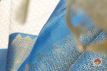 fabric texture of off white kanjivaram silk saree