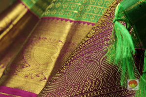 zari detail and fabric texture of  traditional design kanjivaram pure silk sari