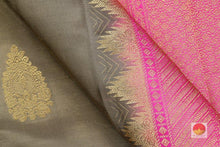 fabric detail of silk yarn in tan and pink kanjivaram silk saree