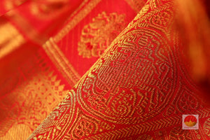 zari detail and fabric texture of kumkuma red kanjivaram pure silk saree