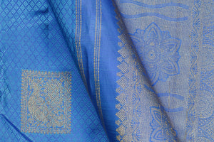 fabric and annapakshi motif detail of silk yarn in blue kanjivaram silk saree