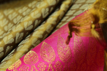 fabric detail of gold zari and silk yarn in kanjivaram silk saree