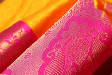 zari detail of  traditional design yellow kanjivaram pure silk sari