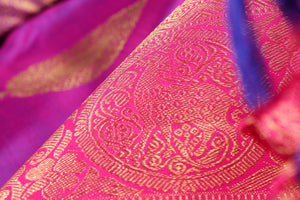 zari detail of  traditional design purple kanjivaram pure silk sari