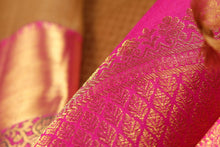zari detail of  traditional design mustard kanjivaram pure silk sari