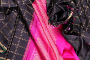 drape of black and pink kanjivaram silk saree