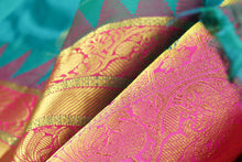 zari detail of  traditional design green kanjivaram pure silk sari
