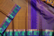 Mustard with jacquard florets on the body and purple pallu with aqua border