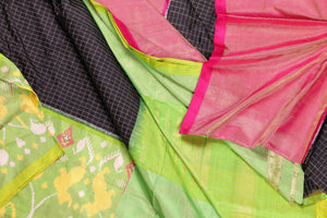 Drape view of black and green pochampally silk saree