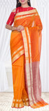 A bright orange saree with double-layered zari borders