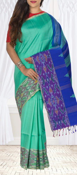 Coral Green & Royal Blue Pure Jute Silk Saree With Ikat Border