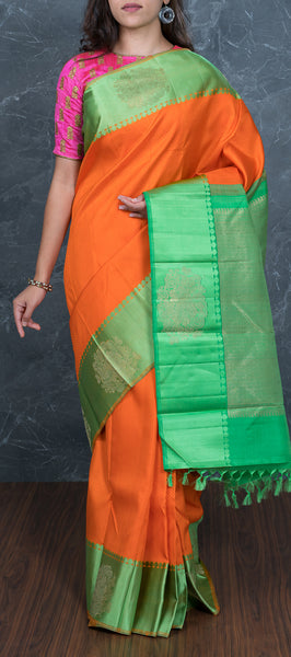 Orange kanchipuram silk saree with green border