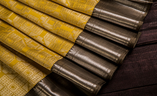 Yellow Folklore Silk Saree