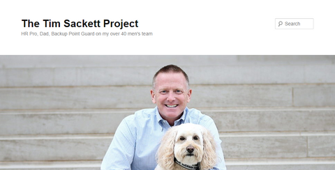 IMAGE OF FOUNDER AND  A DOG
