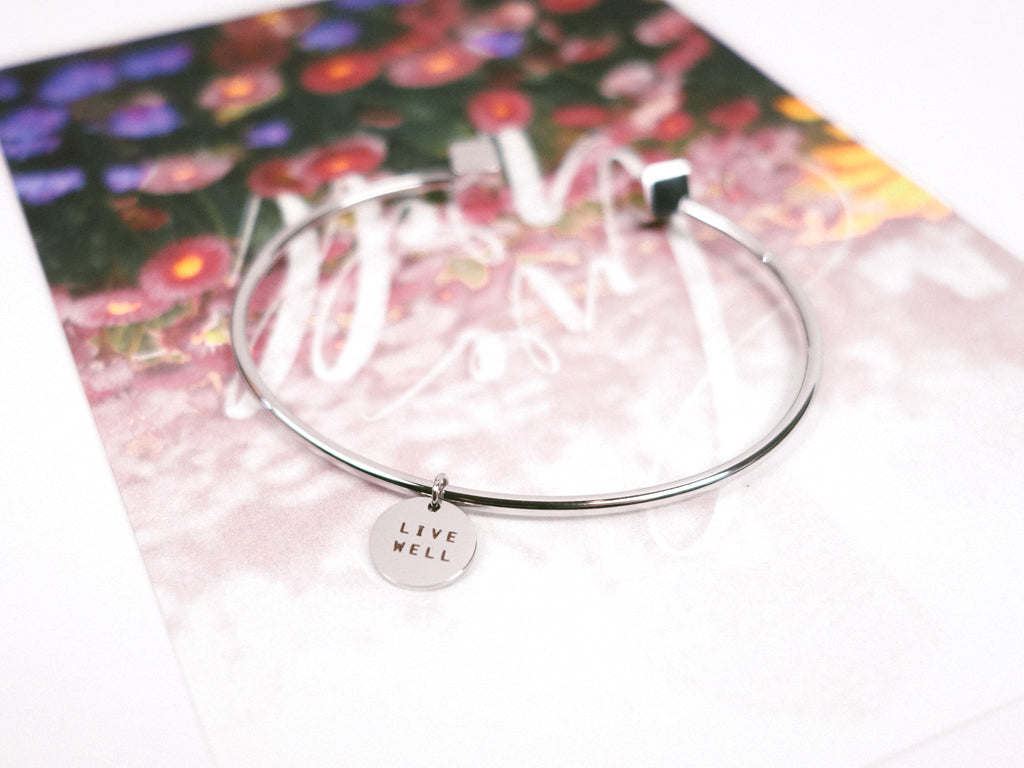 Live Well Round Pendant Bracelet in Silver