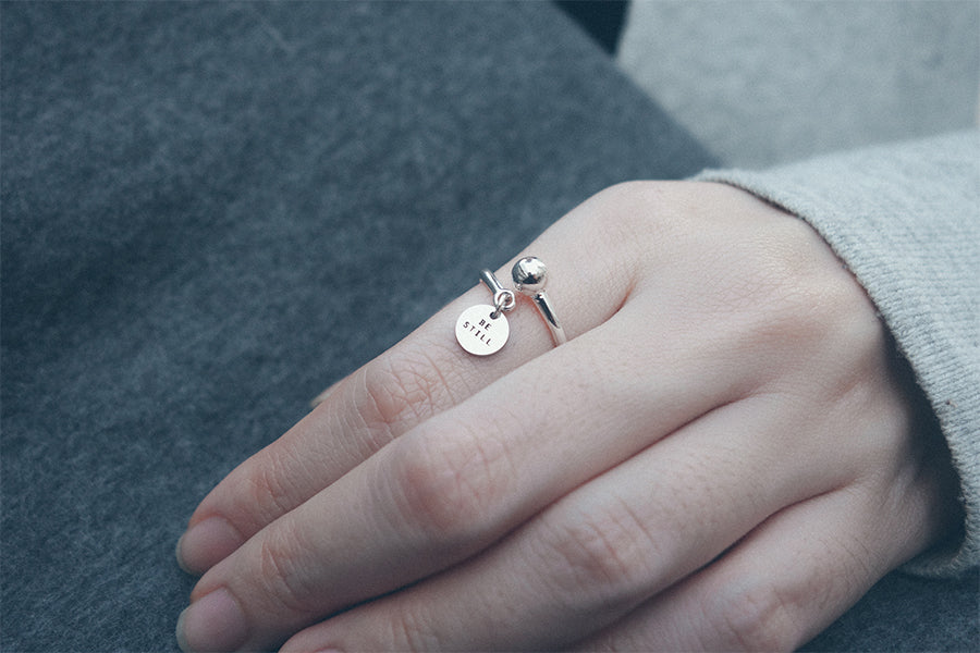 A little message on a ring with round pendant