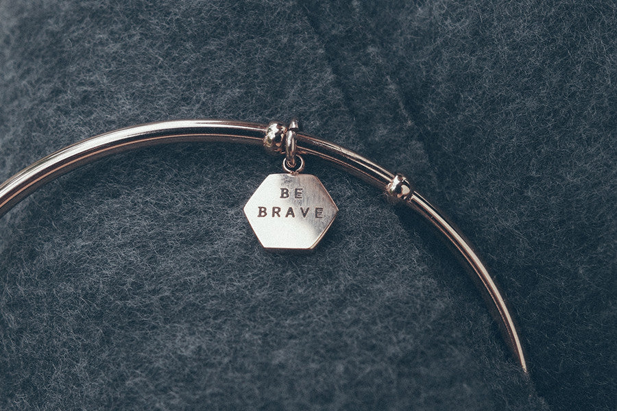 Be brave wrist band with hexagon pendant
