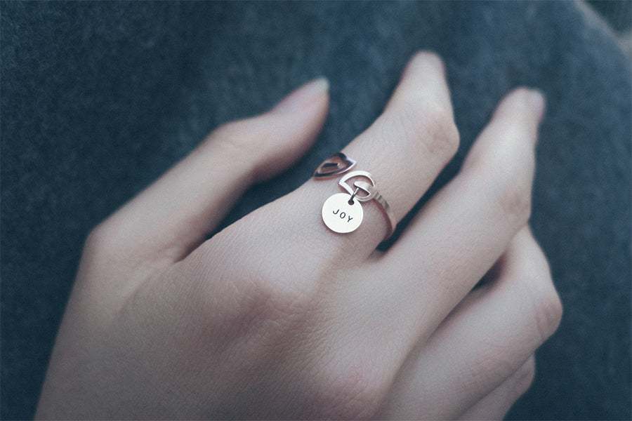 Inspiring message on jewelry with Jco round pendant on leaf ring