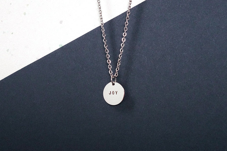 Custom make meaningful jewelry with a simple message on laser engraved pendant