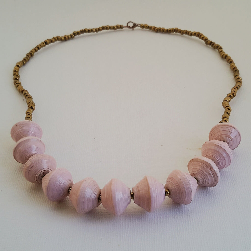 Powder pink hand made ethical design paper bead necklace made out of recycled paper in Uganda by principles of fair trade, ethical and sustainable fashion, empowering women of post war area, by Finnish / Scandinavian brand, Agulu Paper Beads. Eettinen vaaleanpunainen/vaaleanroosa käsintehty design kaulakoru, joka on tehty kierrätyspaperista reilun kaupan periaattein työllistämällä kehitysmaan nasia.