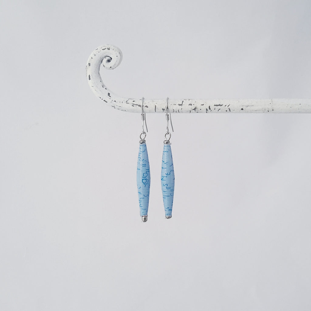 Light blue / sky blue hand made ethical design paper bead earrings made out of recycled paper in Uganda by principles of fair trade, ethical and sustainable fashion, empowering women of post war area, by Finnish / Scandinavian brand, Agulu Paper Beads. Eettiset vaaleansiniset käsintehdyt design korvakorut, jotka on tehty kierrätyspaperista reilun kaupan periaattein työllistämällä Ugandalaisia nasia.