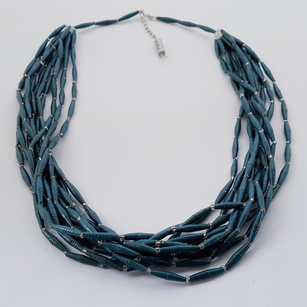 Hand made design paper bead necklace made out of petrol blue recycled paper in Uganda by principles of fair trade, ethical and sustainable fashion, by Finnish brand, Agulu Paper Beads. Eettinen käsintehty design kaulakoru, joka on tehty petroolinvärisestä kierrätyspaperista reilun kaupan periaattein työllistämällä Ugandalaisia naisia.