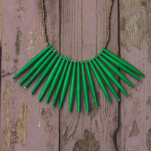 Green hand made design paper bead necklace made out of recycled paper in Uganda by principles of fair trade, ethical and sustainable fashion, empowering women of post war area, by Finnish / Scandinavian brand, Agulu Paper Beads. Eettinen kirkkaan vihreä käsintehty design kaulakoru, joka on tehty kierrätyspaperista reilun kaupan periaattein työllistämällä kehitysmaan nasia.