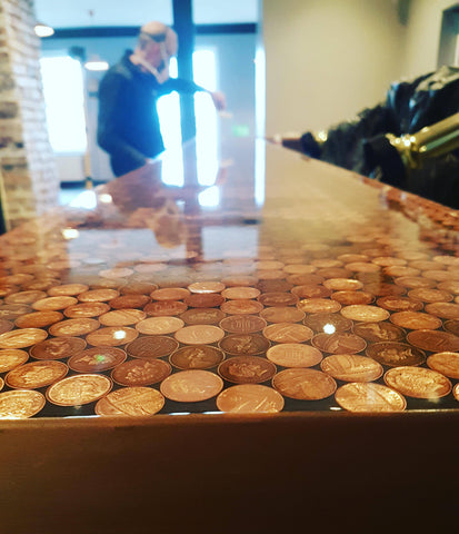 Distressed copper resin edging on a penny bar