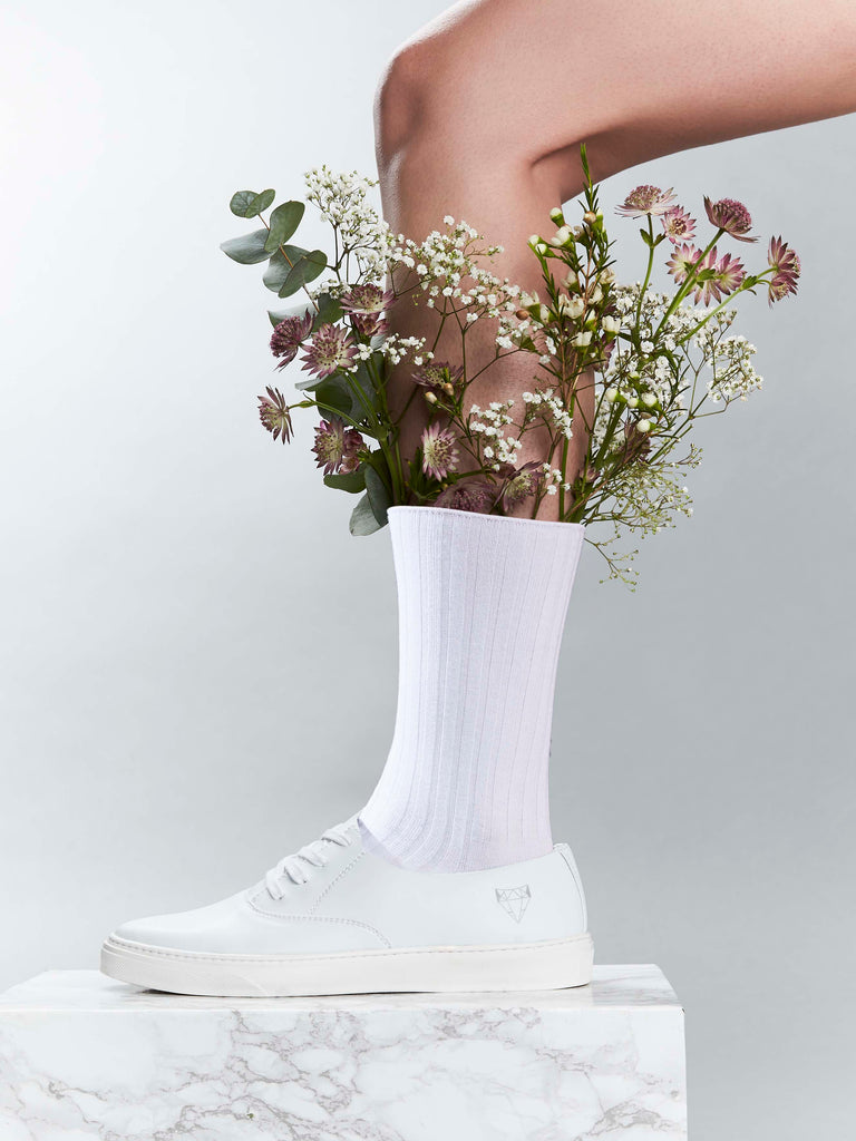 Laika white vegan sneakers made in the EU. Cruelty-free shoes with a minimalist design.