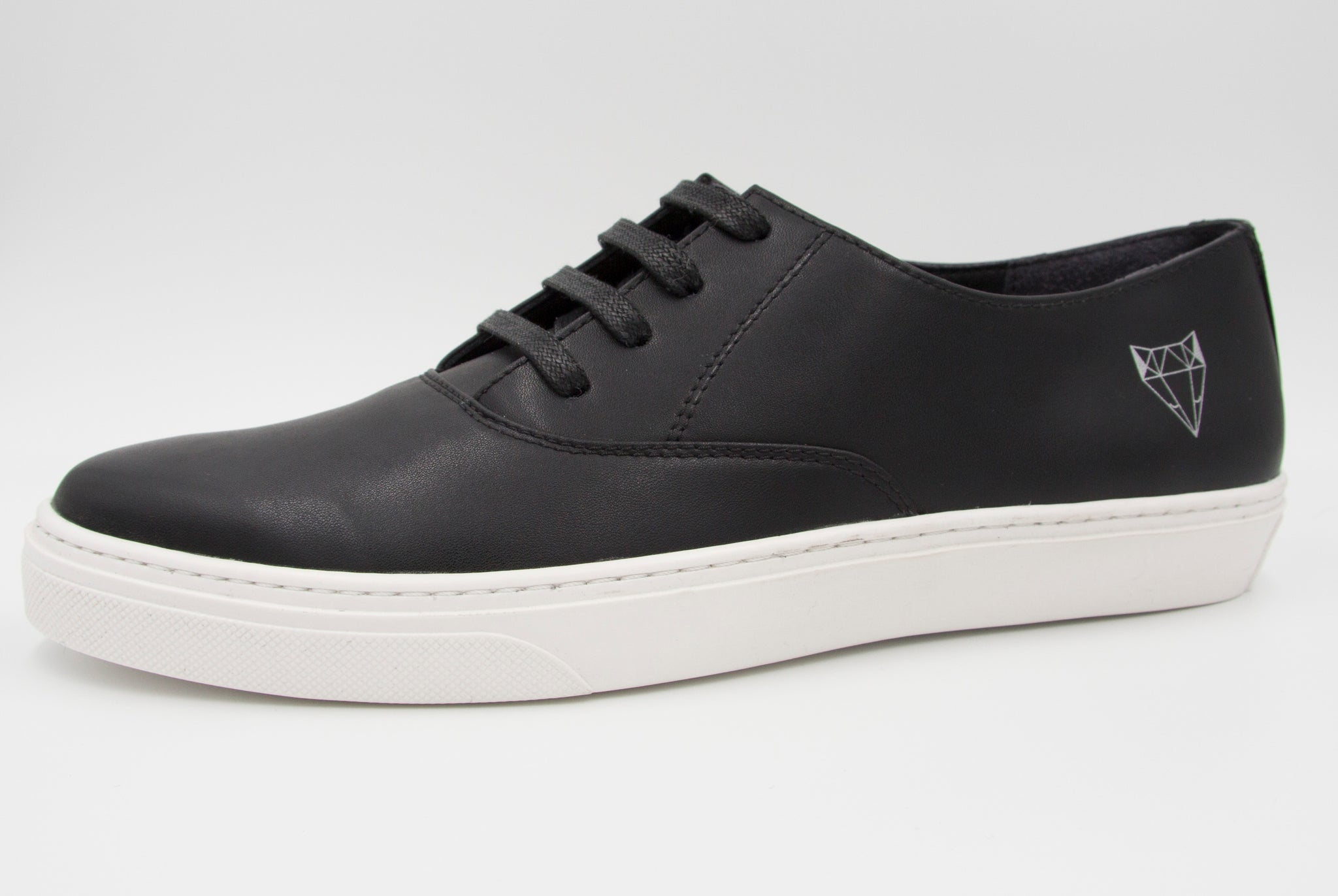 Vegan black sneakers made in the EU of cruelty-free materials.