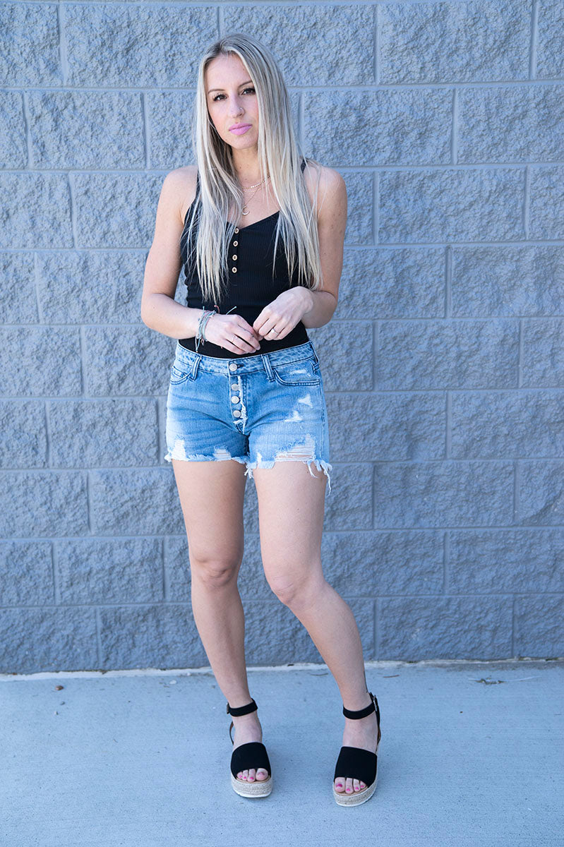 Carli Mid Rise Distressed Button Up Shorts