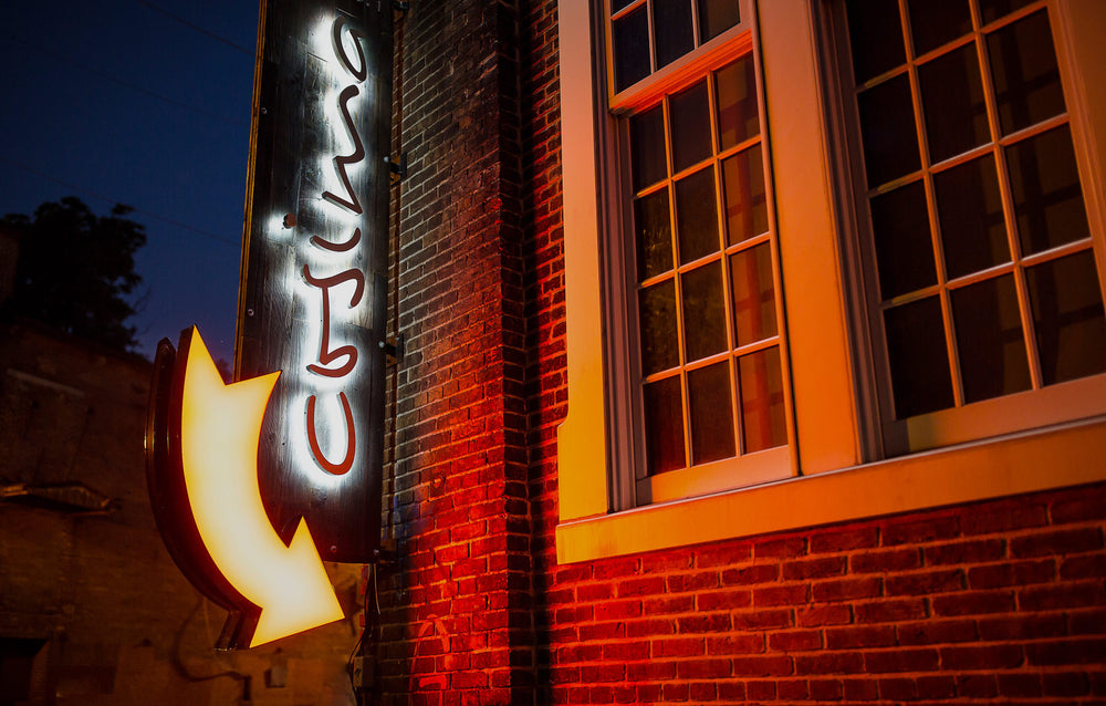 illuminated sign for cosima restaurant