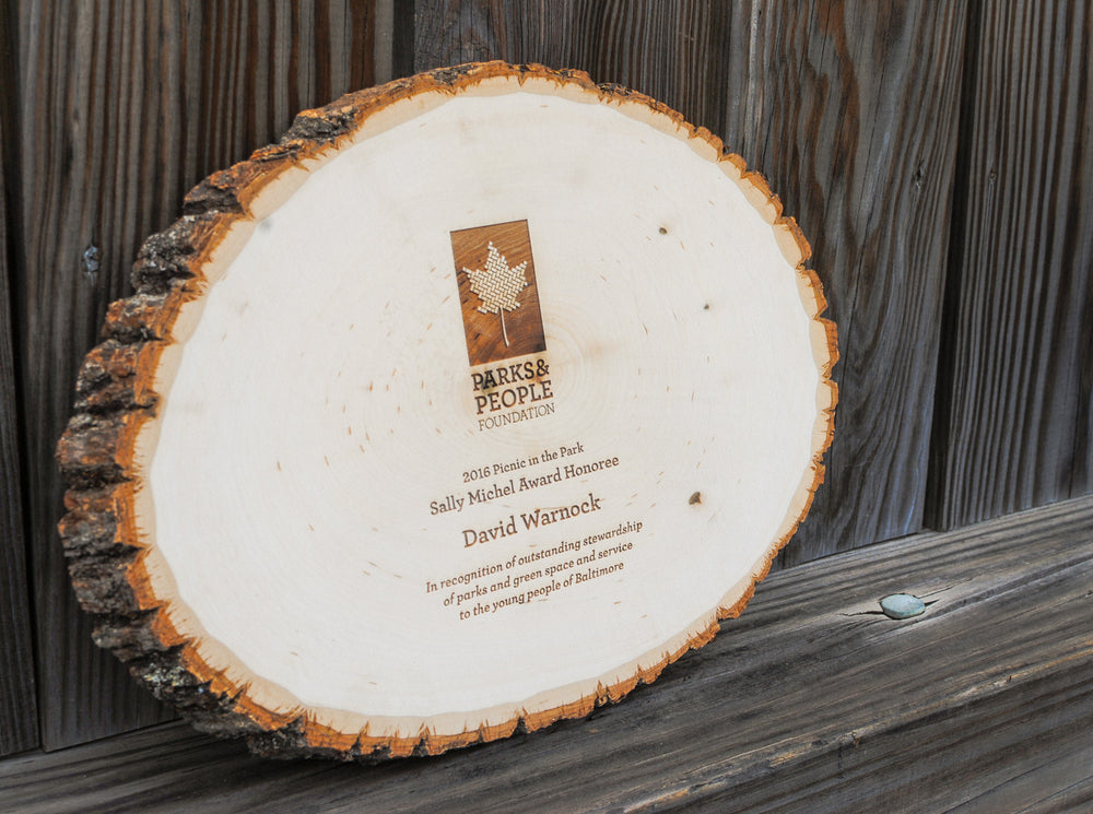 Laser engraved custom award on birch round