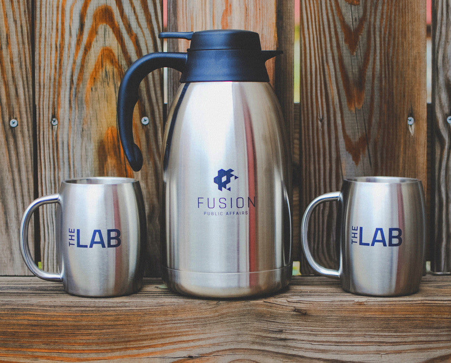 Laser marked etching on stainless steel coffee mugs and carafe.