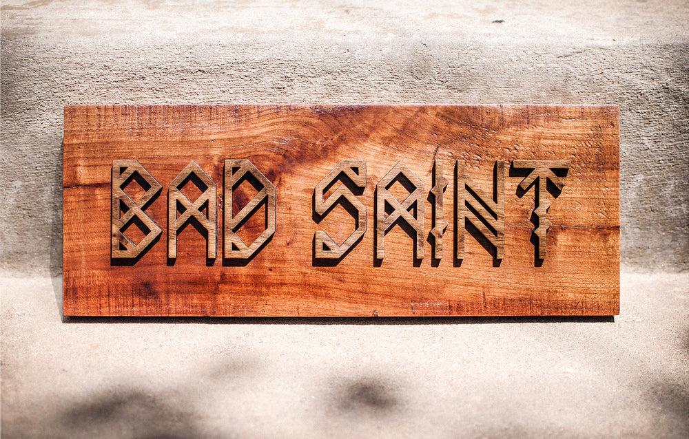 reclaimed cherry and walnut sign for bad saint restaurant