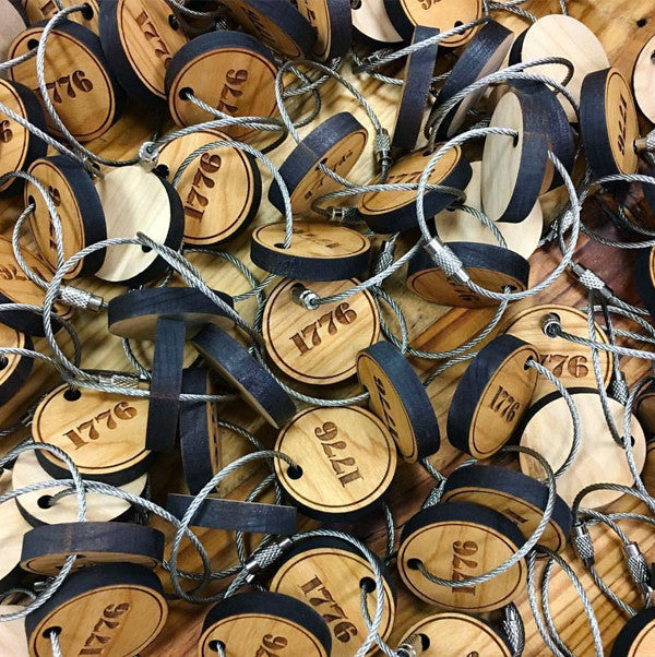 A bunch of custom wooden keychains with laser engraved text