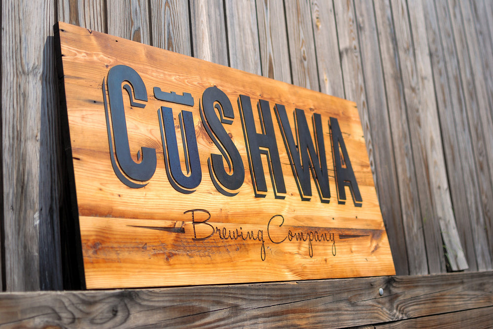 reclaimed heart pine and steel sign for cushwa brewing company