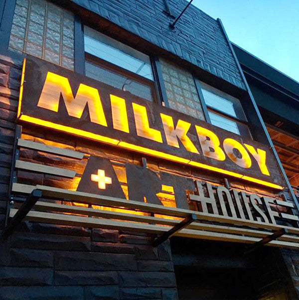 Illuminated steel, acrylic, and cypress wood sign for Milkboy Arthouse