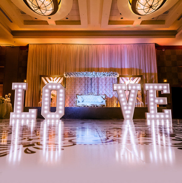 5 foot tall marquee style letters that spell LOVE