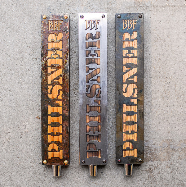 three custom tap handles made of reclaimed wood and steel.