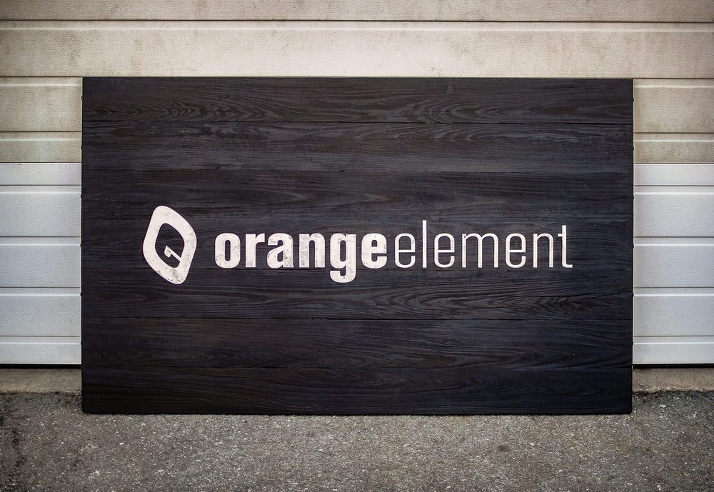 burnt wood shou sugi ban and steel sign for orange element