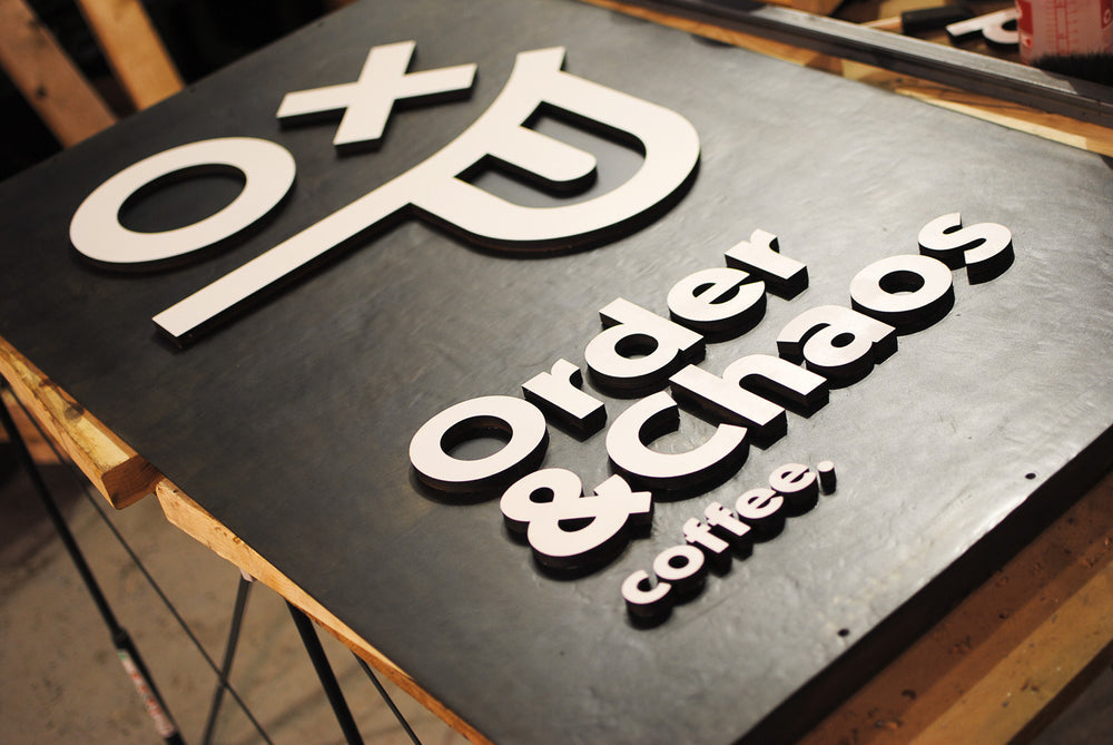 steel and wood custom sign for order & chaos coffee in baltimore md
